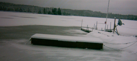 wooden floating dock on a frozen lake