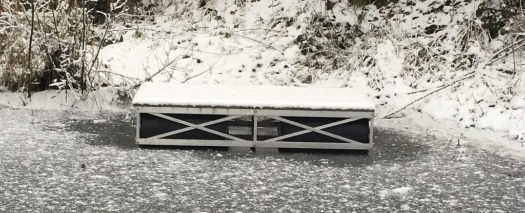 truss dock on freezing lake